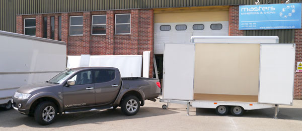Megan Twin type approved light weight trailer towed by L200